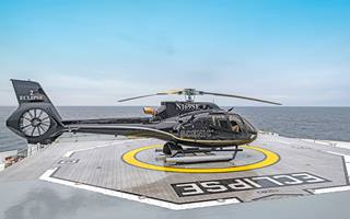 Scenic Eclipse helicopter on a helipad, Scenic Excursions